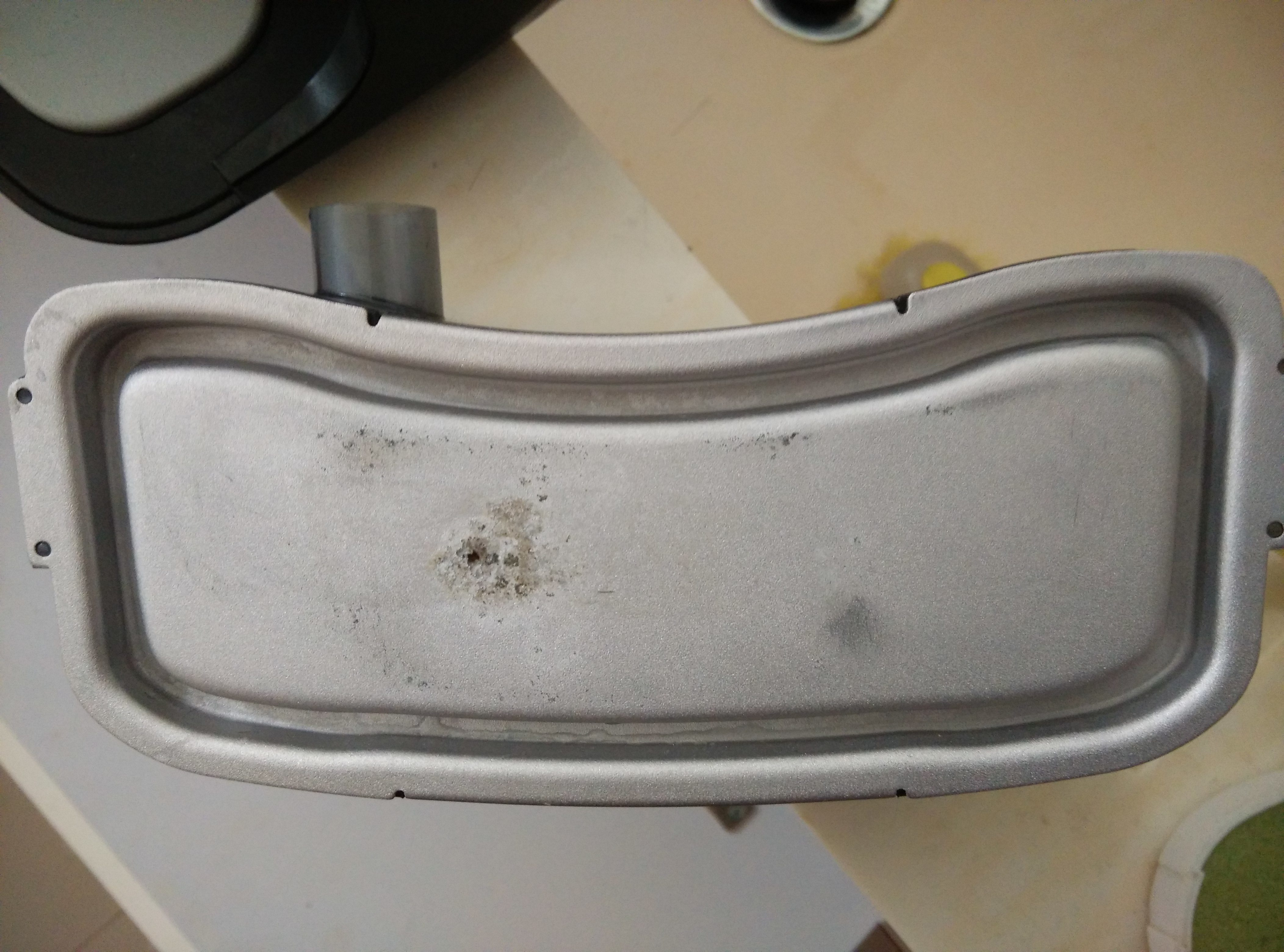 Damage caused to the metal heating plate by sediment build up